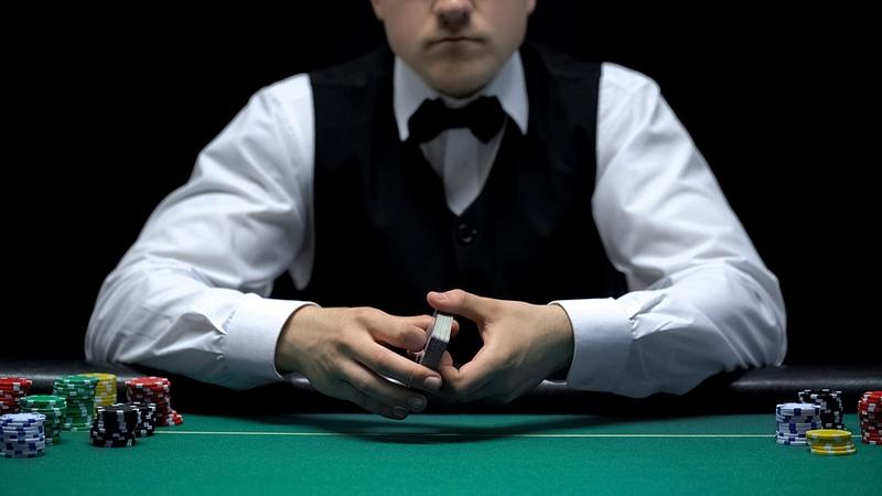 Dealer Holding Cards